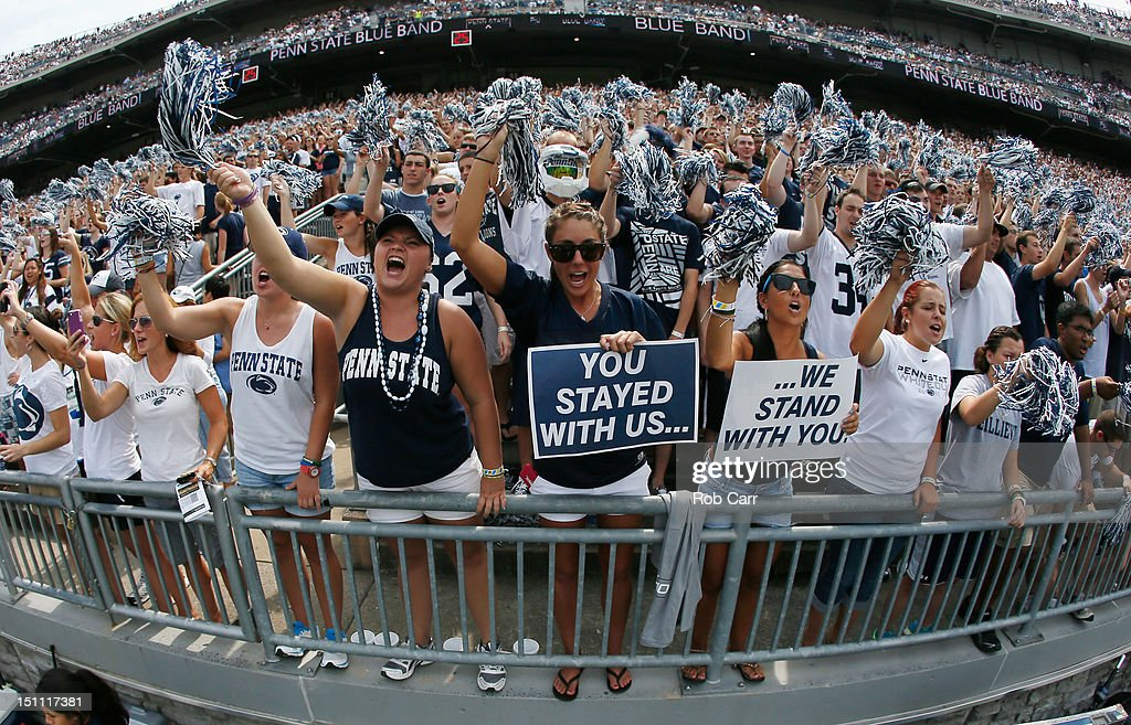 Fan cheer before the start of the Penn State Nittany Lions and Ohio Bobcats game at Beaver Stadium on September 1, 2012 in State College, Pennsylvania.