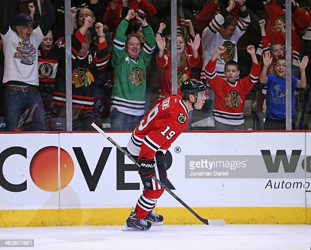 Fan cheer Jonathan Toews after he scored a goal in a the shootout against the Chicago Blackhawks of the Boston Bruins at the United Center on January...