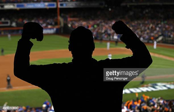 A fan cheers as David Wright of the New York Mets rounds the bases after hitting a two run home run in the first inning against the Kansas City...