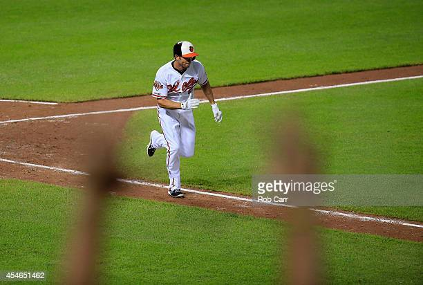 A fan cheers as JJ Hardy of the Baltimore Orioles runs out a two RBI go ahead single against the Cincinnati Reds to give the Orioles a 97 win at...