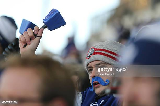 TORONTO ON JANUARY 1 A fan cheers as the Toronto Maple Leafs play the Detroit Red Wings alumni in the Centennial Classic at Exhibition Stadium in...