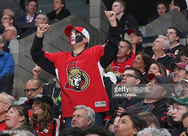 A fan cheers during a game between the Ottawa Senators and the Tampa Bay Lightning at Canadian Tire Centre on April 2 2015 in Ottawa Ontario Canada