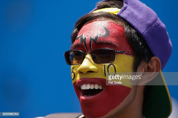 A fan cheers during day two of the 2016 Australian Open at Melbourne Park on January 19 2016 in Melbourne Australia