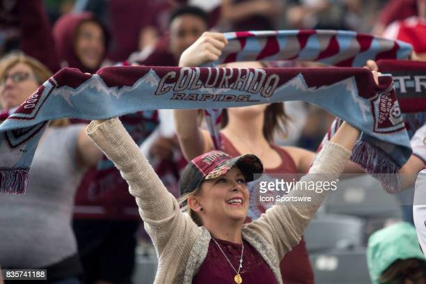 A fan cheers during the Colorado Rapids game vs the DC United on August 19 2017 at Dick's Sporting Goods Park in Denver CO