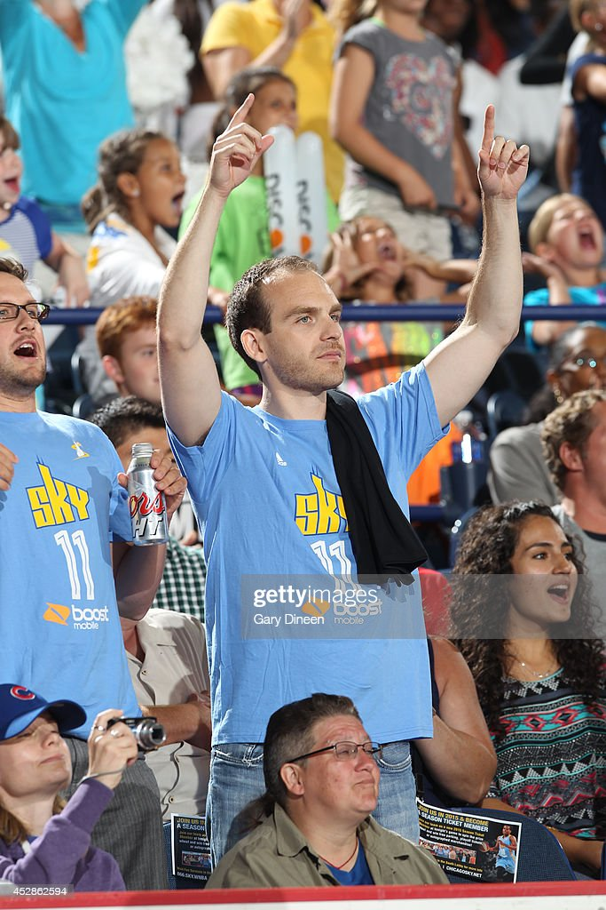 A fan cheers during the game between the Indiana Fever and Chicago Sky on July 22, 2014 at the Allstate Arena in Rosemont, Illinois.