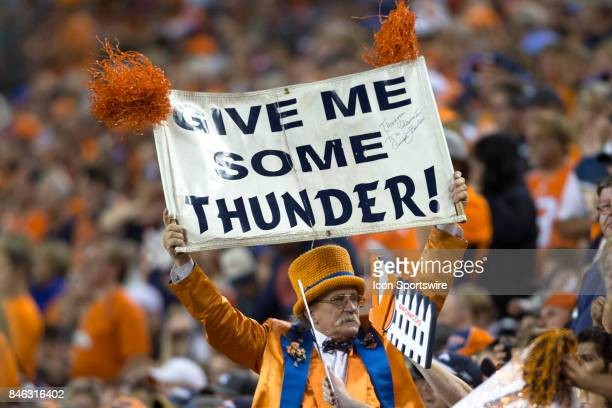 A fan cheers during the Los Angeles Chargers vs Denver Broncos Monday Night Football game on September 11 at Sports Authority Field in Denver CO