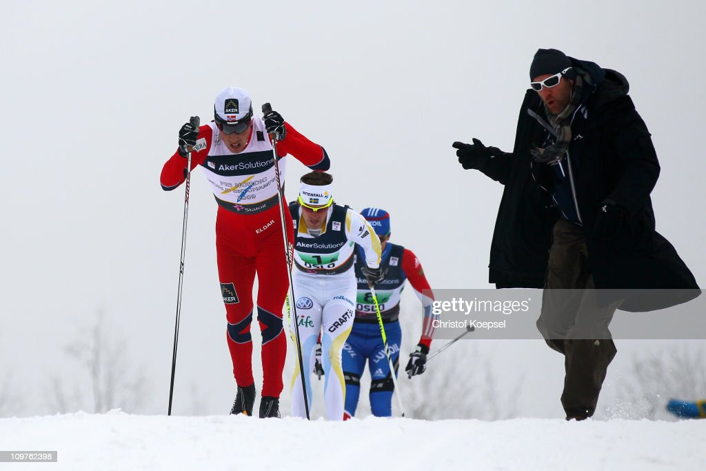 A fan cheers on Eldar Roenning of Norway, <a gi-track='captionPersonalityLinkClicked' href=/galleries/search?phrase=Johan+Olsson&family=editorial&specificpeople=724246 ng-click='$event.stopPropagation()'>Johan Olsson</a> of Sweden and Stanislav Volzhentsev of Russia in the Men's Cross Country 4x10km Relay race during the FIS Nordic World Ski Championships at Holmenkollen on March 4, 2011 in Oslo, Norway.