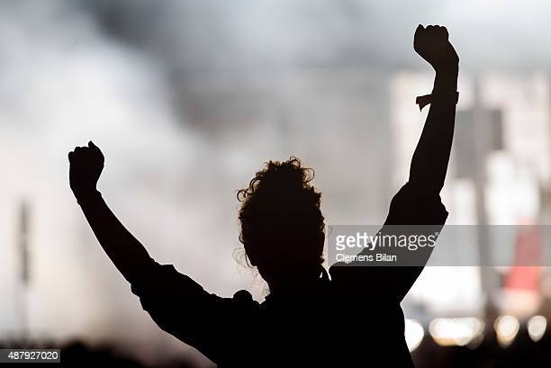 A fan cheers on the first day of the Lollapalooza Berlin music festival at Tempelhof Airport on September 12 2015 in Berlin Germany