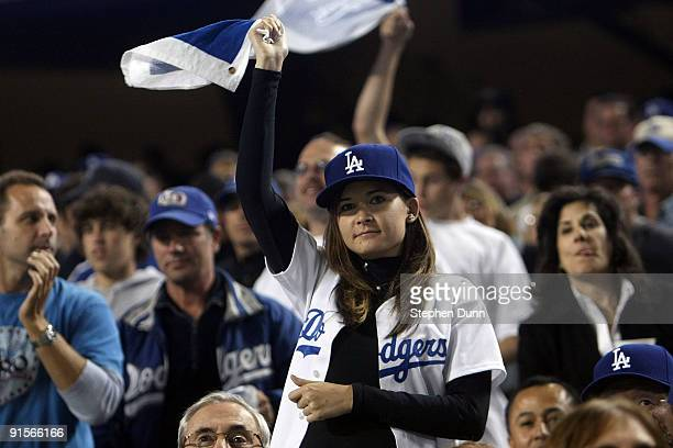 A fan cheers on the Los Angeles Dodgers against the St Louis Cardinals in Game One of the NLDS during the 2009 MLB Playoffs at Dodger Stadium on...