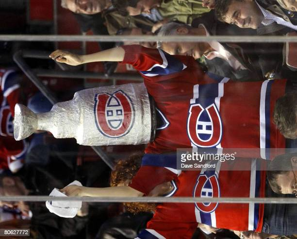 A fan cheers on the Montreal Canadiens as they face the Boston Bruins during Game One of the 2008 NHL Eastern Conference Quarterfinals at the Bell...