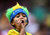 A fan cheers prior to the 2014 FIFA World Cup Brazil Group A match between Croatia and Mexico at Arena Pernambuco on June 23 2014 in Recife Brazil