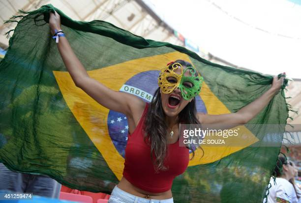A fan cheers prior to the Group G football match between Portugal and Ghana at the Mane Garrincha National Stadium in Brasilia during the 2014 FIFA...