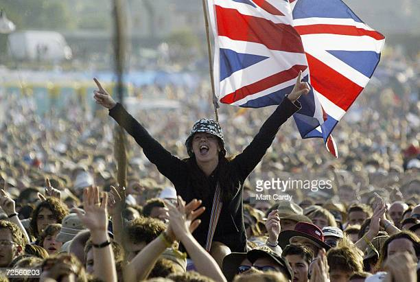 A fan cheers the band Franz Ferdinand during the 2004 Glastonbury Festival on June 25 2004 at Worthy Farm Pilton Somerset England The music festival...