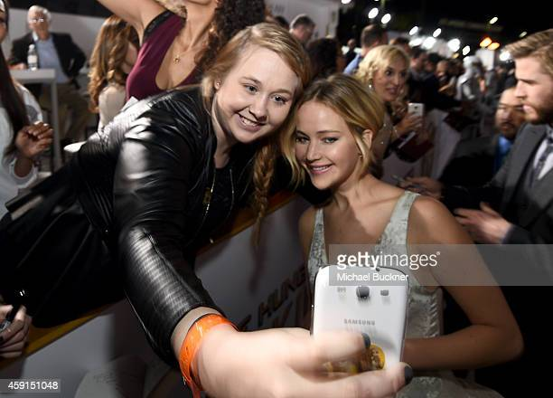 Fan Chelsea Boyce takes a Wide Angle Selfie with actress Jennifer Lawrence using the new Samsung Galaxy Note 4 at the release of The Hunger Games...
