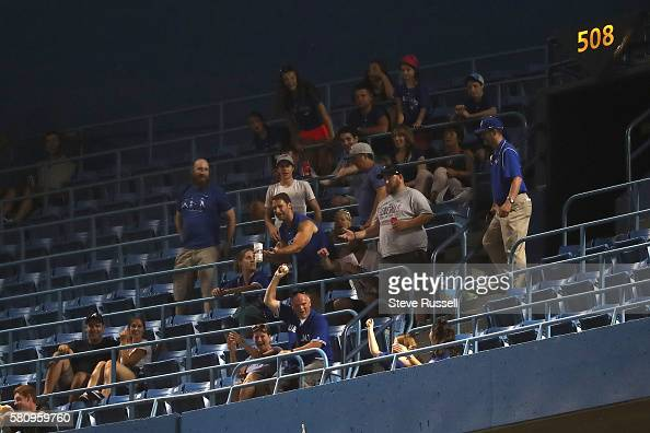 TORONTO ON JULY 25 A fan comes up with San Diego Padres left fielder Alex Dickerson's two run homer into the fifth deck as the Toronto Blue Jays beat...