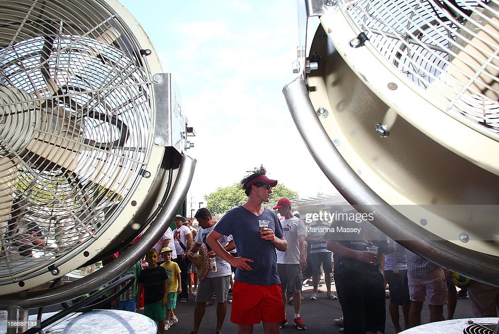 A fan cools off from the heat in the Vodafone misters during day one of the Third Test match between Australia and Sri Lanka at Sydney Cricket Ground on January 3, 2013 in Sydney, Australia.