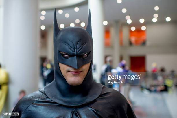 A fan cosplays as Batman during 2017 New York Comic Con Day 1 on October 5 2017 in New York City