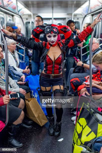 A fan cosplays as Harley Quinn on the Subway on the way back home from 2017 New York Comic Con Day 1 on October 5 2017 in New York City
