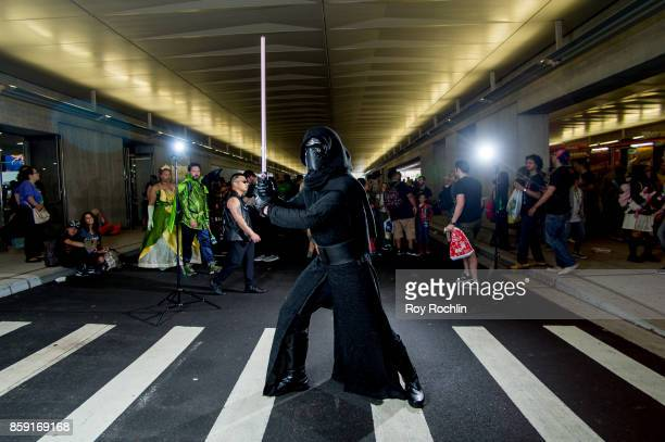 A fan cosplays as Kylo Ren from Starwars during the 2017 New York Comic Con Day 4 on October 8 2017 in New York City
