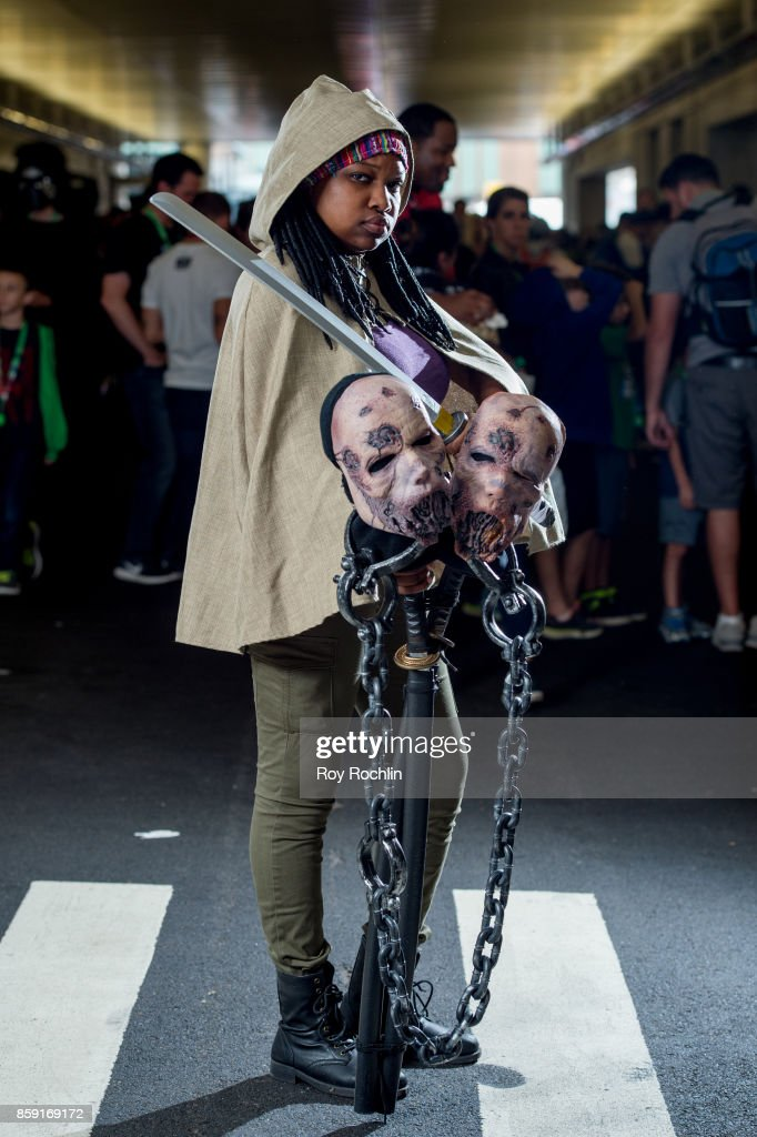 A fan cosplays as Michonne from Walking Dead during the 2017 New York Comic Con - Day 4 on October 8, 2017 in New York City.