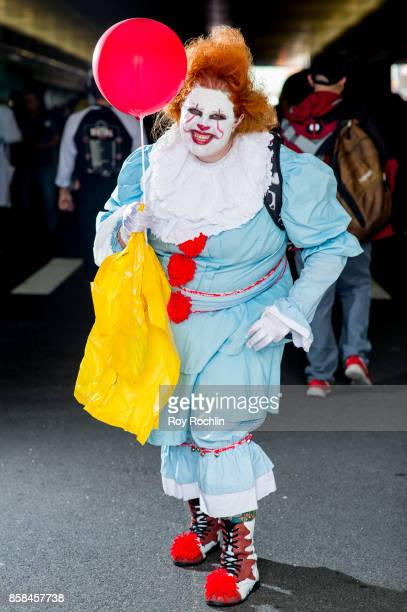A fan cosplays as Pennywise the Dancing Clown from the movie IT during 2017 New York Comic Con Day 2 on October 6 2017 in New York City