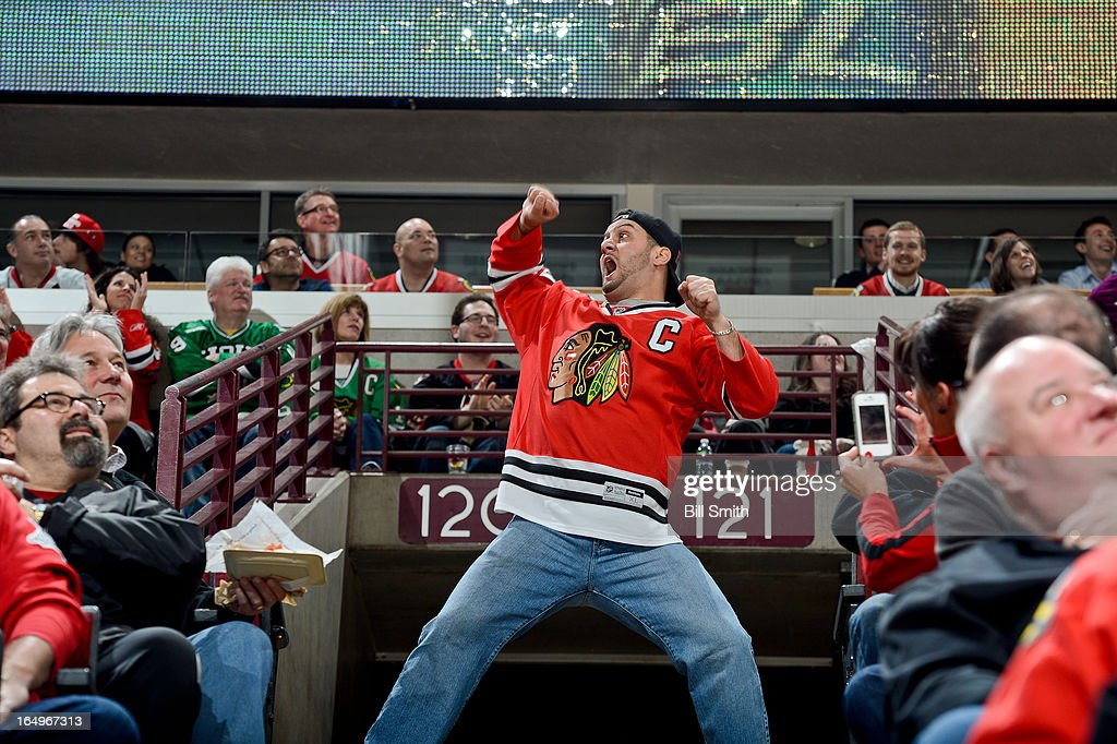 A fan dances during the NHL game between the Anaheim Ducks and the Chicago Blackhawks on March 29, 2013 at the United Center in Chicago, Illinois.