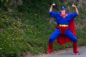 A fan disguised as Superman character poses as he waits for the pack in the 1435 km and seventeenth stage of the 2012 Tour de France cycling race...
