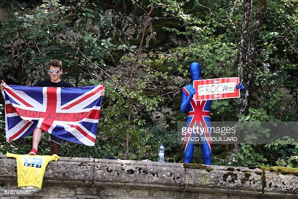 A fan disguised with colours of the Great Britain's Union Jack flag and holding a placard reading [Great Britain's Christopher] Froome and a fan...