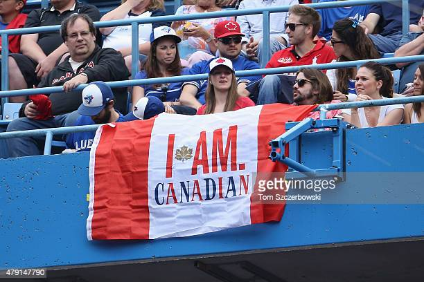 A fan displays a Canadian flag with the Molson Canadian slogan from the upper deck on Canada Day during the Toronto Blue Jays MLB game against the...