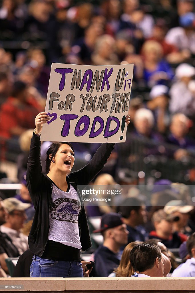 A fan displays a sign in support of Todd Helton #17 of the Colorado Rockies as he faces the Boston Red Sox on the eve of his final game at Coors Field on September 24, 2013 in Denver, Colorado. The Rockies defeated the Red Sox 8-3.