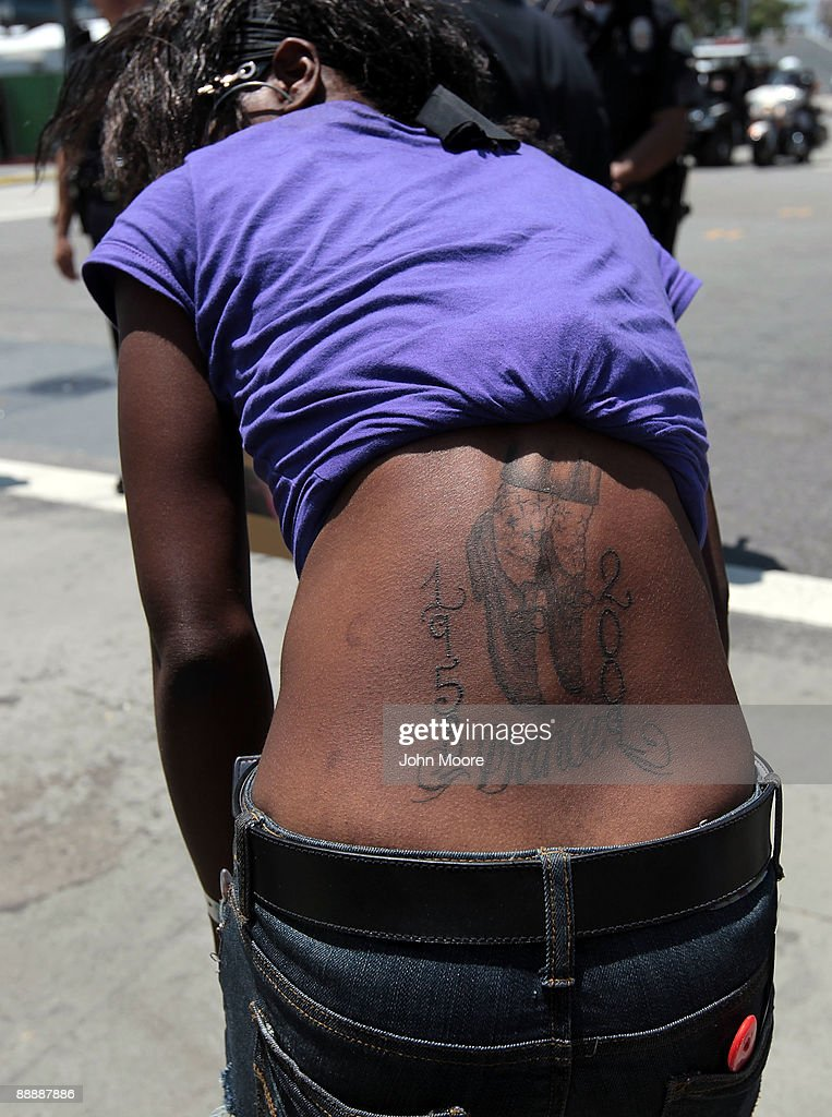 A fan displays a tattoo in remembrance of Michael Jackson outside at the Michael Jackson public memorial service held at Staples Center on July 7, 2009 in Los Angeles, California. Jackson, 50, the iconic pop star, died at UCLA Medical Center after going into cardiac arrest at his rented home on June 25 in Los Angeles, California.