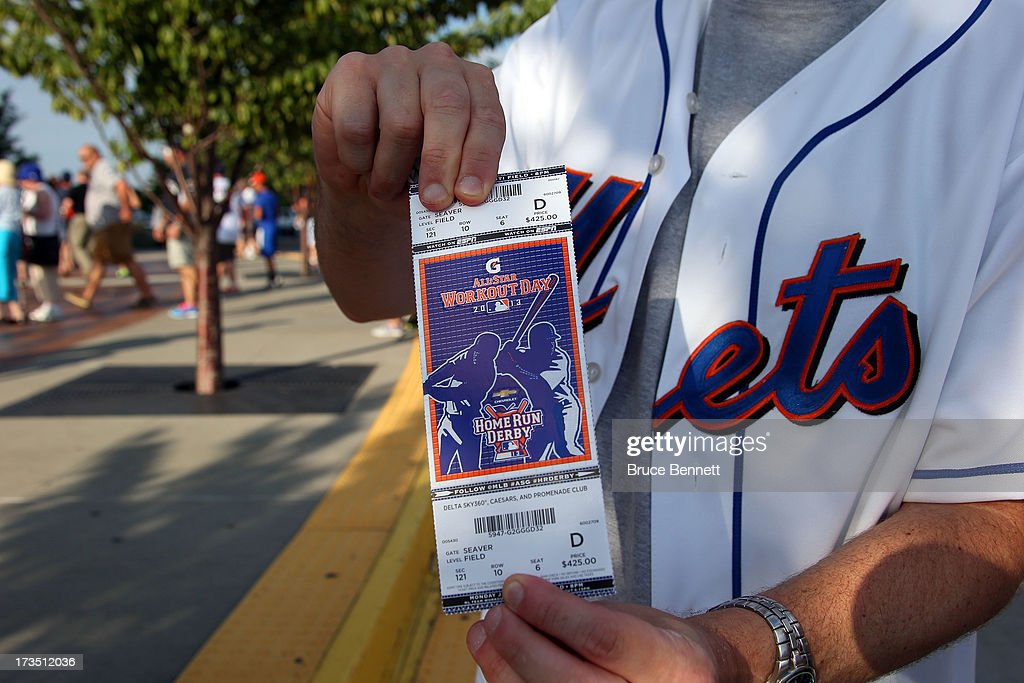 A fan displays a ticket during Gatorade All-Star Workout Day on July 15, 2013 at Citi Field in the Flushing neighborhood of the Queens borough of New York City.