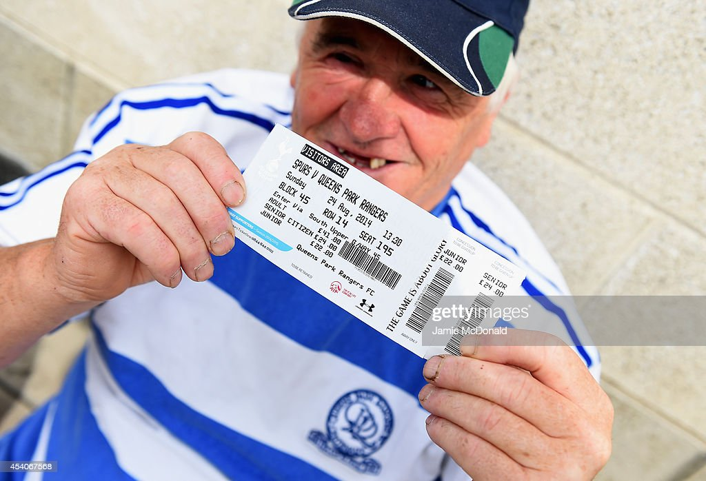 A QPR fan displays his match ticket prior to the Barclays Premier League match between Tottenham Hotspur and Queens Park Rangers at White Hart Lane on August 24, 2014 in London, England.