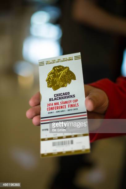 A fan displays the ticket for Game Seven of the Western Conference Final between the Los Angeles Kings and the Chicago Blackhawks during the 2014 NHL...