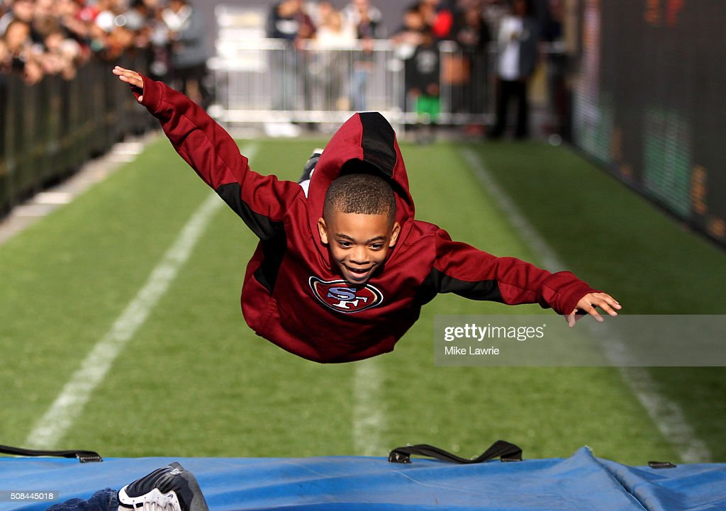A fan dives after running the 40 yard dash at The 50th Mile on Market Street prior to Super Bowl 50 on February 4, 2016 in San Francisco, United States.