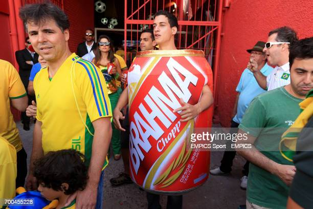 A fan dress in a giant Brahma can before the match