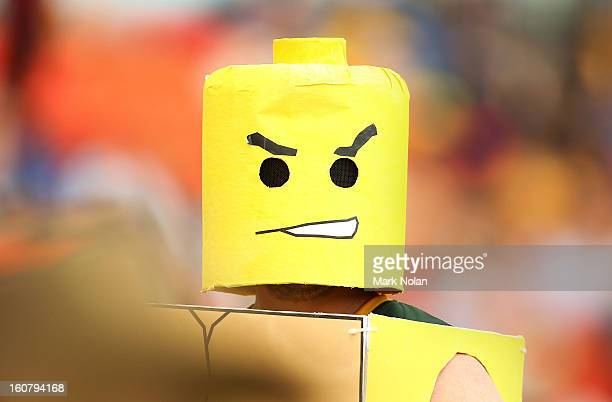 A fan dressed as a lego figurine watches on during the Commonwealth Bank One Day International Series between Australia and the West Indies at Manuka...