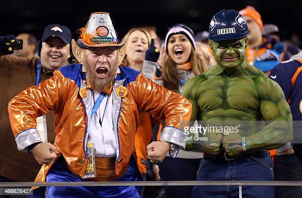 A fan dressed as a leprechaun and one as the hulk cheer for the Denver Broncos and the Seattle Seahawks during Super Bowl XLVIII at MetLife Stadium...