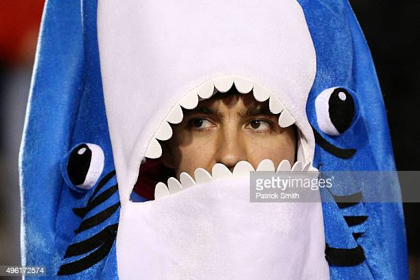 A fan dressed as a shark looks on as the Maryland Terrapins play the Wisconsin Badgers during the second half at Byrd Stadium on November 7 2015 in...