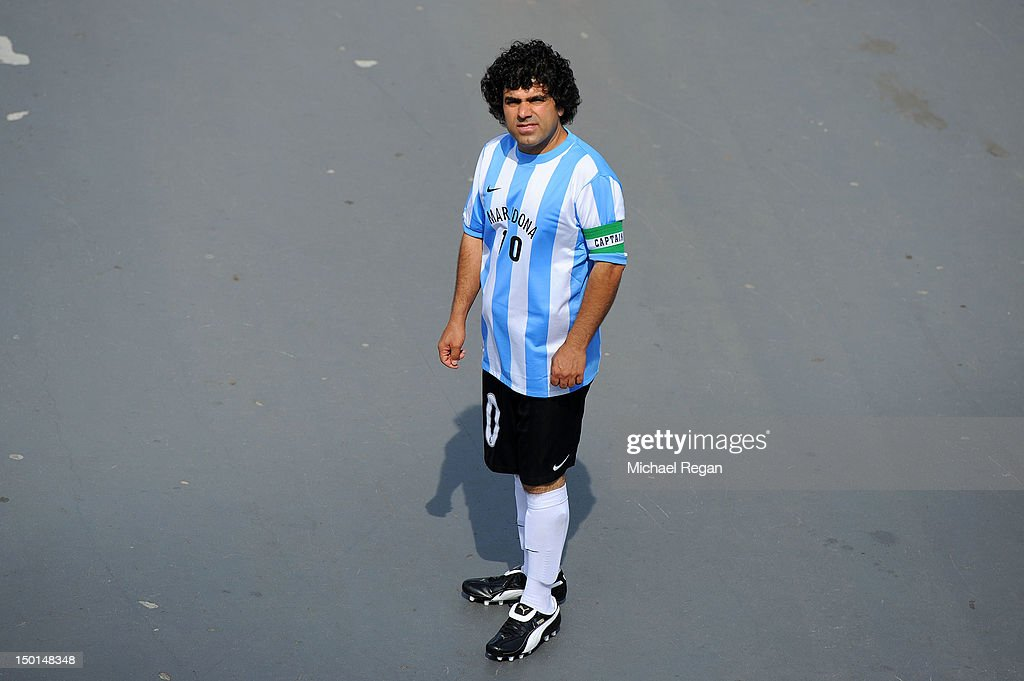 A fan dressed as Diego Maradona enjoys the atmosphere ahead of the Men's Football Final between Brazil and Mexico on Day 15 of the London 2012 Olympic Games at Wembley Stadium on August 11, 2012 in London, England.
