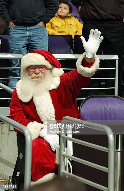 A fan dressed as Santa Clause attends the game between the Los Angeles Clippers and the Milwaukee Bucks during the game at Staples Center on December...