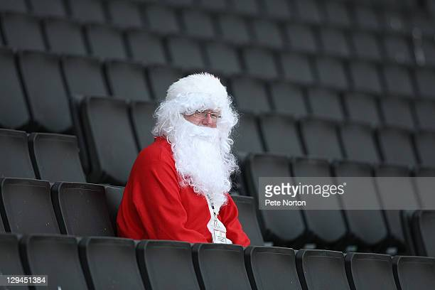 A fan dressed as Santa Claus looks on prior to the npower League One match between MK Dons and AFC Bournemouth at stadiummk on October 15 2011 in...