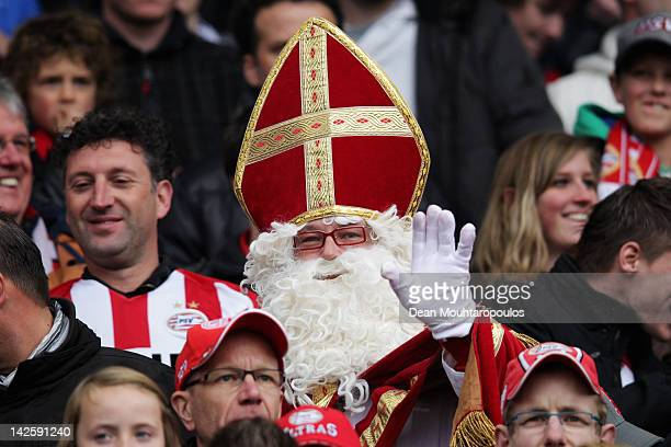 PSV fan dressed as sinterklaas looks on during the Dutch Cup Final between PSV Eindhoven and SC Heracles Almelo at Feijenoord Stadion on April 8 2012...