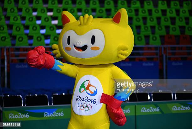 A fan dressed as the Olympic Games mascot Vinicius cheers ahead of a match during the Rio 2016 Olympic Games in Rio de Janeiro on August 11 2016 /...