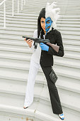 A fan dressed as TwoFace from the Batman comics poses for photos at ComicCon International day 3 on July 22 2016 in San Diego California