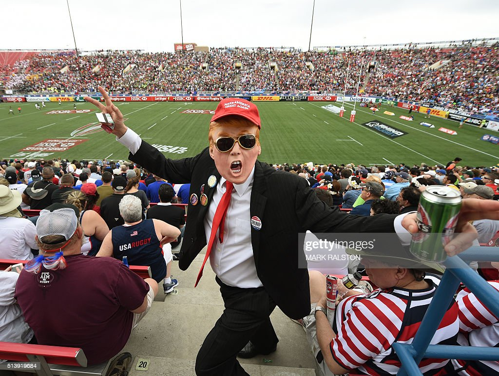 A fan dressed as US Republican presidential hopeful Donald Trump poses in the crowd during day two of the Men's 2016 USA Sevens Rugby Tournament match at the Sam Boyd Stadium in Las Vegas, Nevada on March 5, 2016. / AFP / MARK