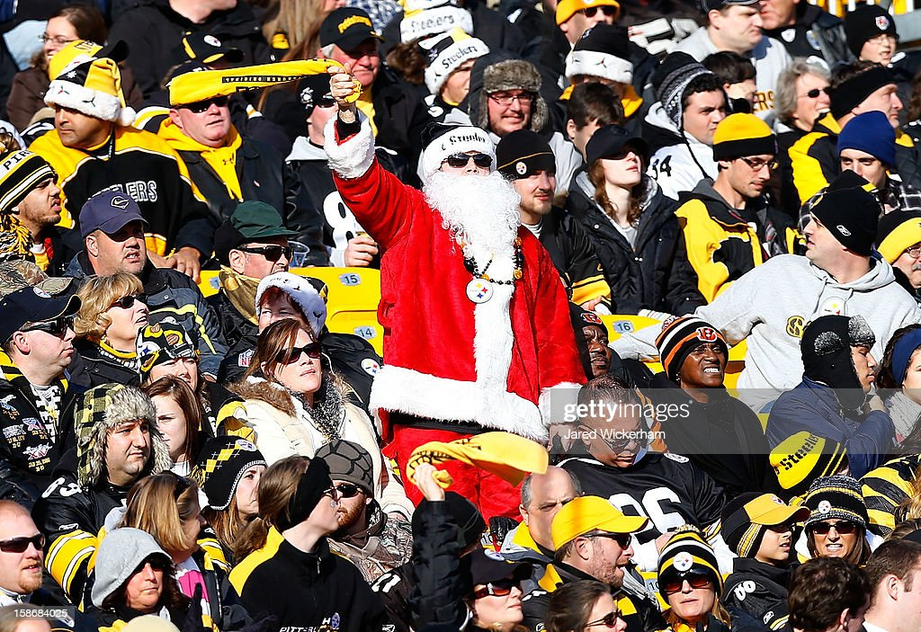 A fan dressed up as Santa Claus waves his Terrible Towel during the game between the Pittsburgh Steelers and the Cincinnati Bengals at Heinz Field on December 23, 2012 in Pittsburgh, Pennsylvania.