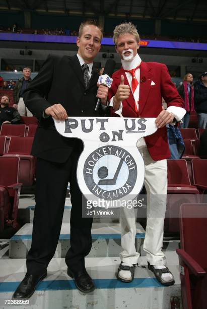 A fan dressedup as a Don Cherry lookalike for Halloween poses for a photo with a friend prior to the game between the Vancouver Canucks and the...