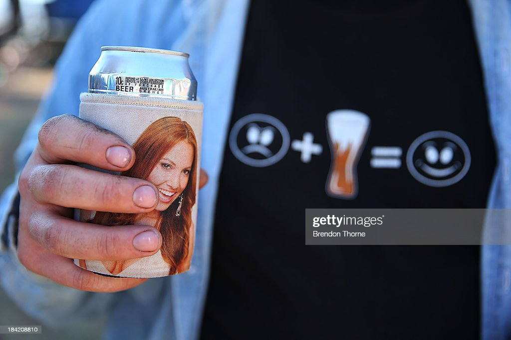A fan drinks a beer during the Bathurst 1000, which is round 11 of the V8 Supercars Championship Series at Mount Panorama on October 12, 2013 in Bathurst, Australia.