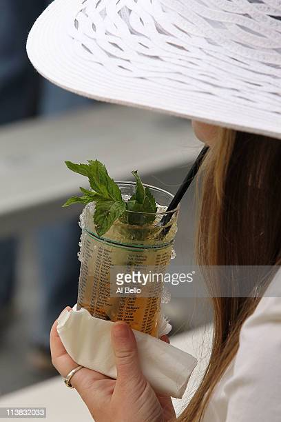 A fan drinks a mint julep while sitting in the grandstand during the 137th Kentucky Derby at Churchill Downs on May 7 2011 in Louisville Kentucky
